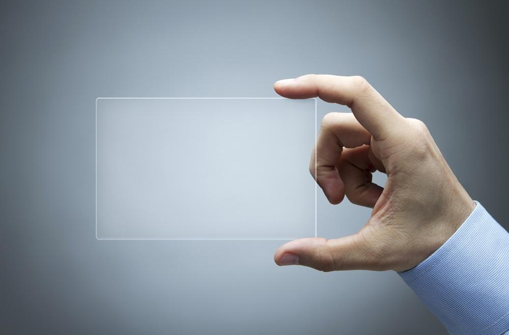 PMMA czyste optycznie / Human hand holding futuristic business card